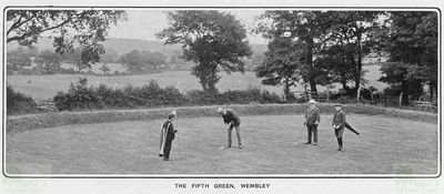 Wembley Golf Club. Golfers and caddies on the fifth green.