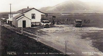 Towyn-on-Sea Golf Club, Gwynedd. The clubhouse and Beacon Hill.